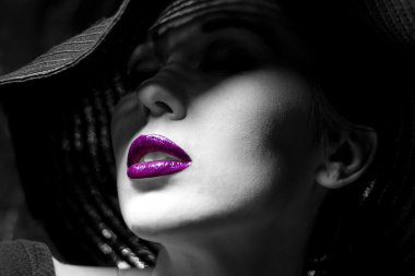 Mysterious woman in black hat. Purple  lips
