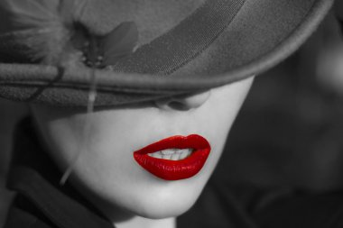 Woman in  hat. Red lips.