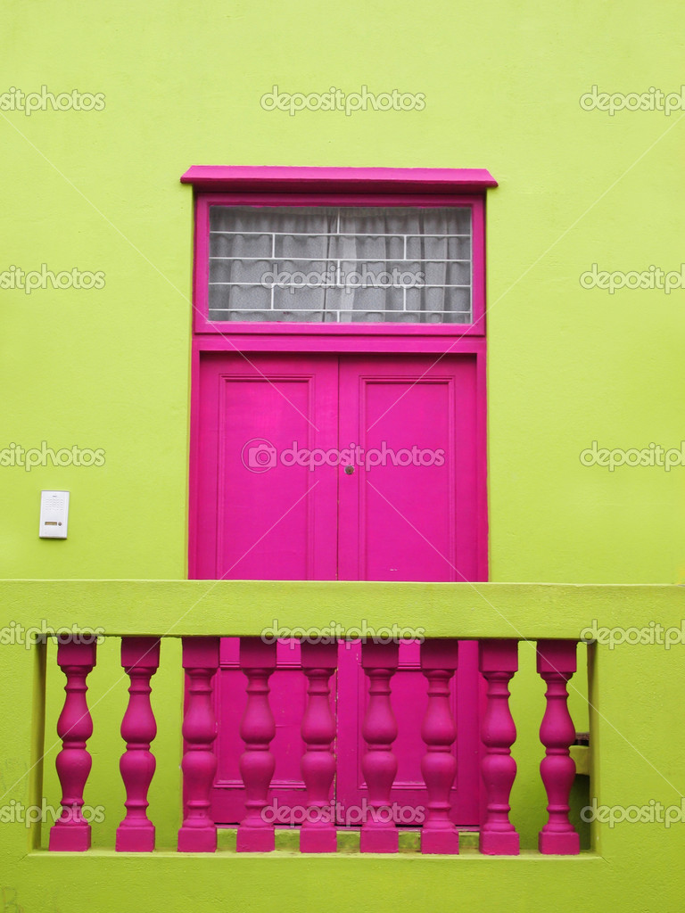 Wall. Door to balcony. Bright colors. Deep pink and yellow-green ...