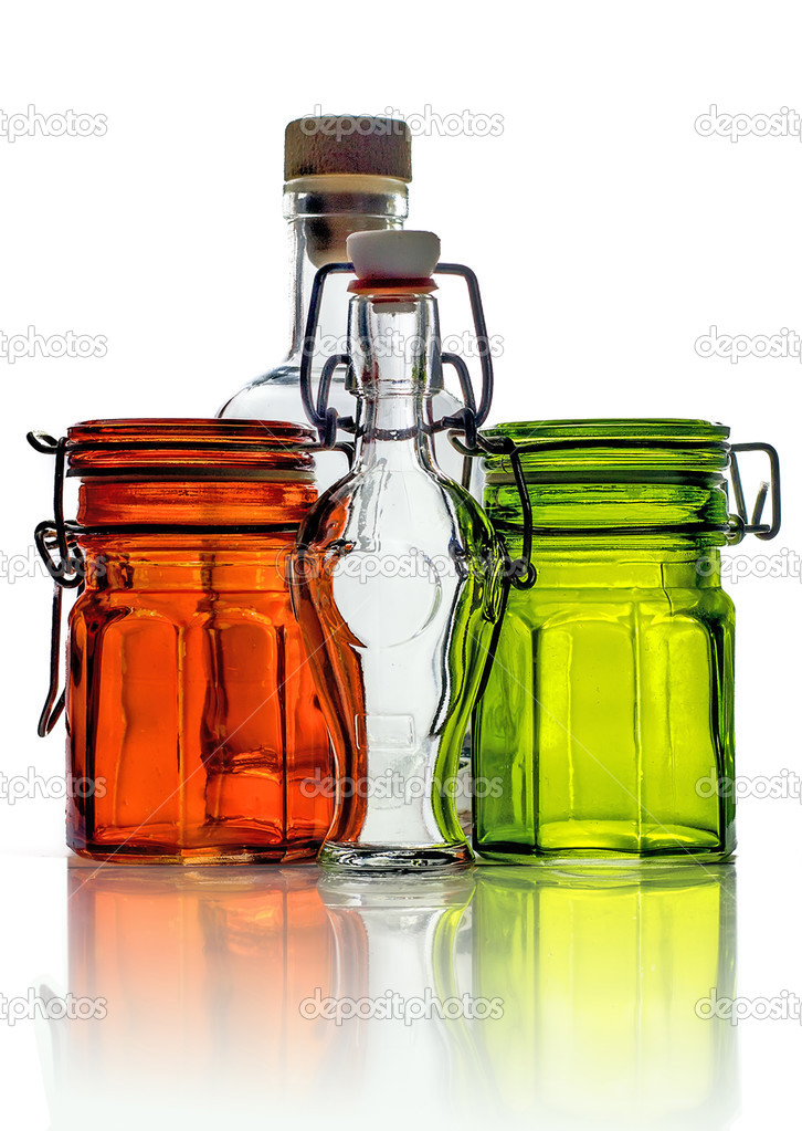 empty glass jars and empty little glass bottle with clamp stoppe