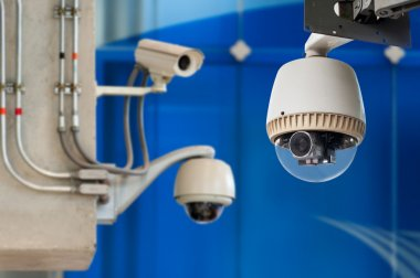 3 CCTV camera or surveillance operating on blue bakcground