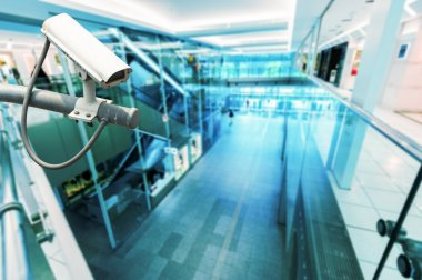 CCTV Camera or surveillance operating in building hightech blue