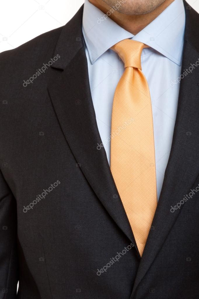 terno preto com gravata laranja � fotografias de stock