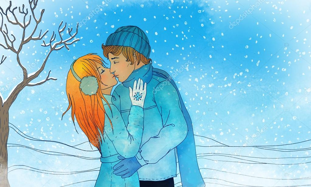 Young loving couple kissing in a winter