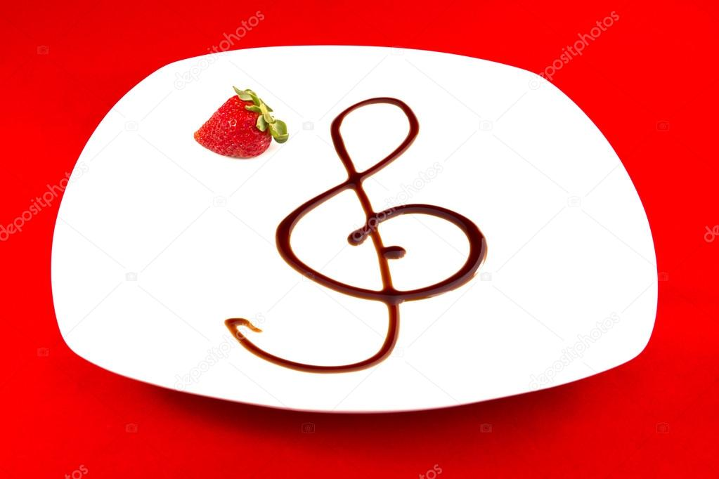 Treble Clef With Balsamic Vinegar On White Plate With Decoration Of
