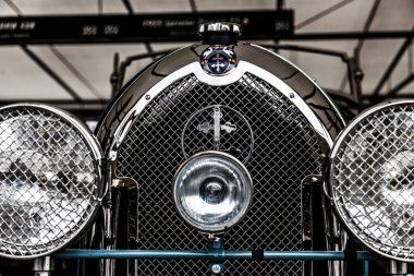 Badge grille and radiator cap on vintage car at Goodwood Revival
