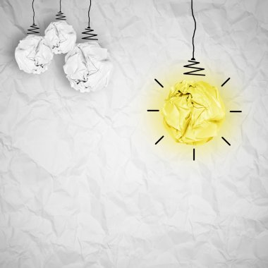 light bulb crumpled paper as creative concept