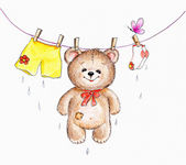 Teddy bear hanging on washing line