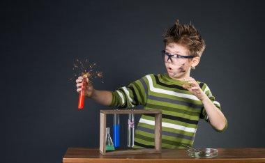 Little boy performing experiments. Crazy scientist.