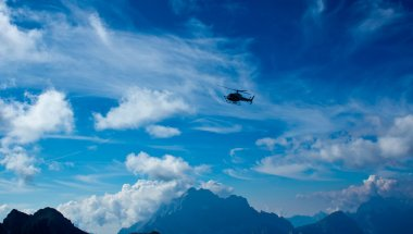 Helicopter flying on the Dolomiti