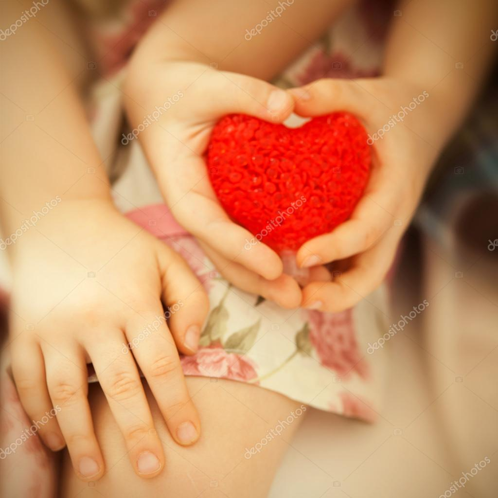 Little Boy And Girl Holding In Hands Red Heart Stock Photo
