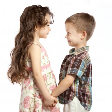 little girl holding the boy's hand