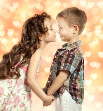 little girl kissing boy