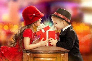 Happy children opening magic gift