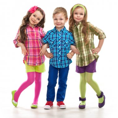 Cute fashion kids are standing together