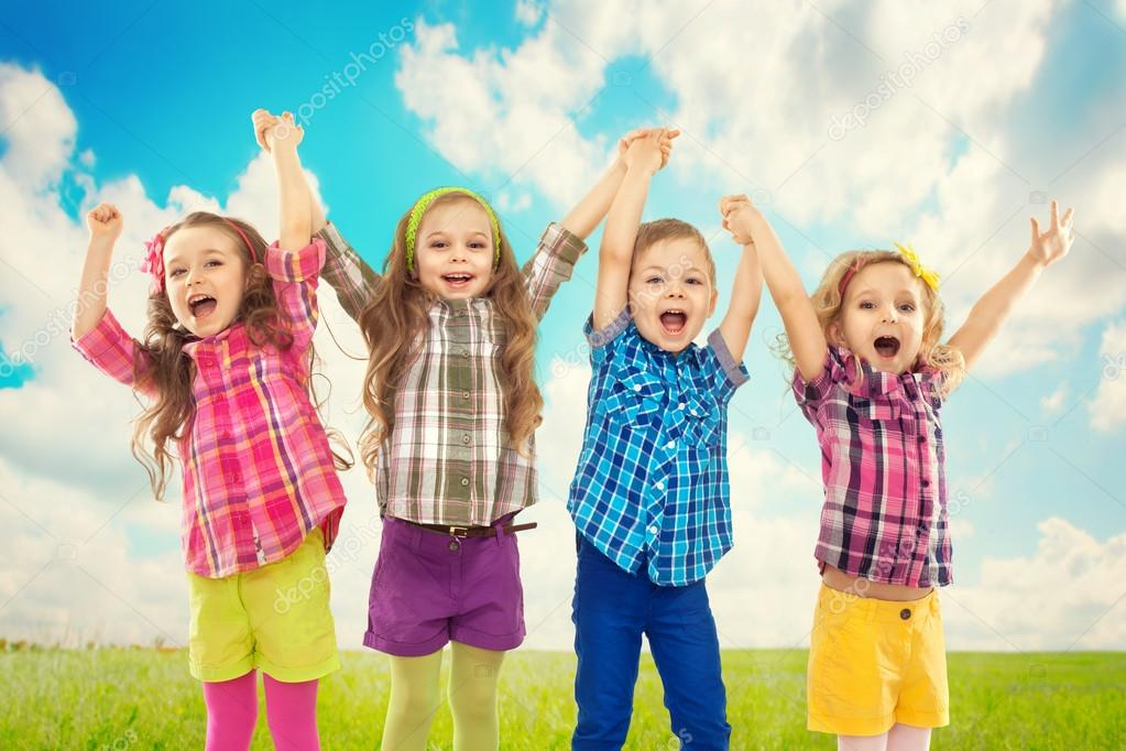 Cute happy kids are jumping together.