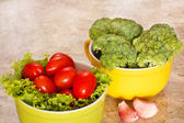 Fresh broccoli, tomatoes in bowls
