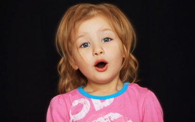Adorable little girl singing expressively