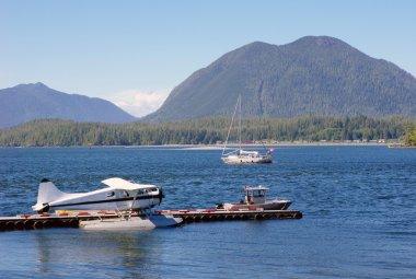 Seaplane, boats in Tofino port Vancouver Island, Canada