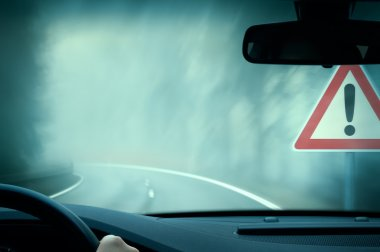 Bad weather driving - country road - caution fog stock vector