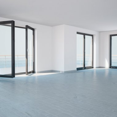 Bright empty room with large windows and a balcony