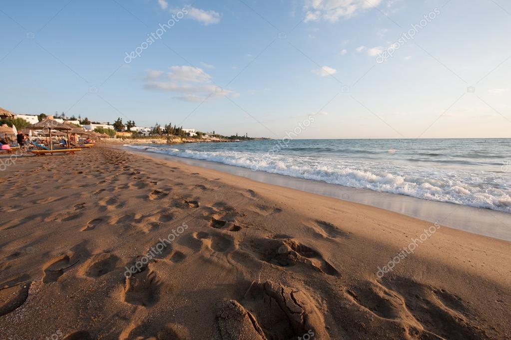 Sunrise over a deserted sandy beach
