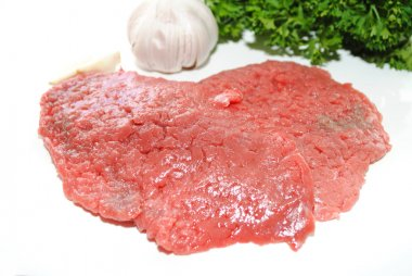 Raw Beef Cube Steaks with Fresh Garlic and Herbs