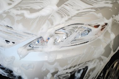 Car Covered with Soap Suds in a Washing Bay