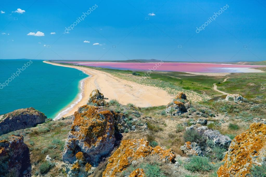 View from the mountains to the sea coast and mud pink lake