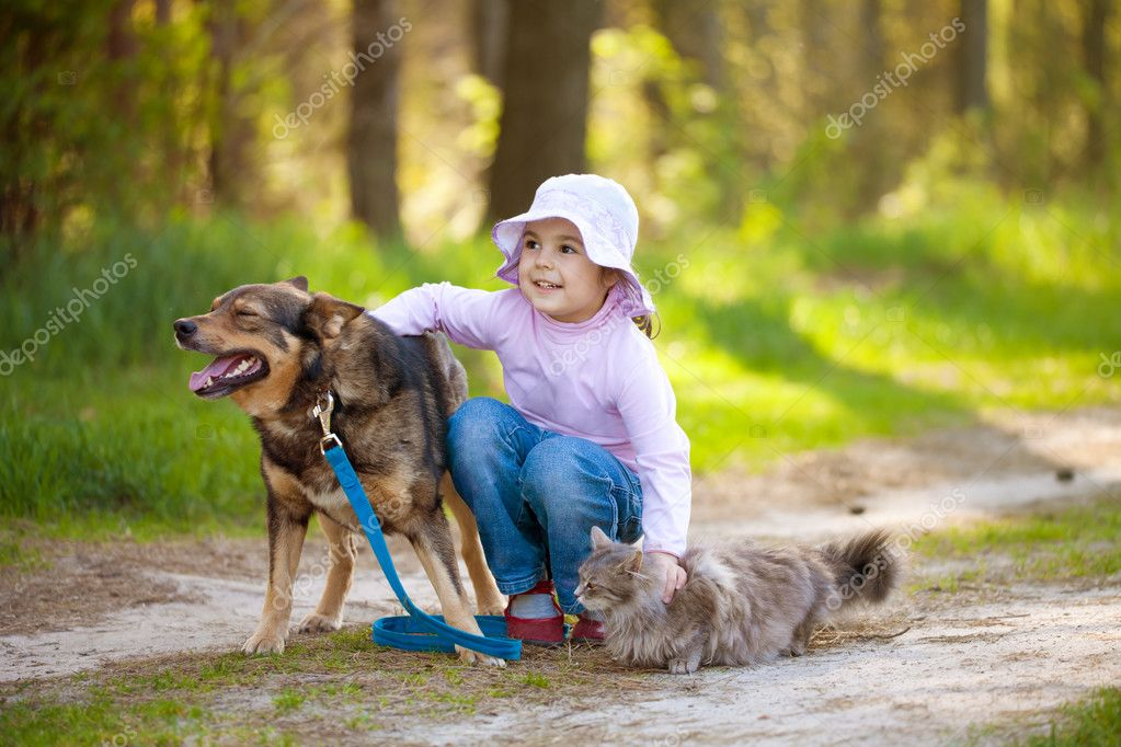 Girl with big dog and cat in the forest