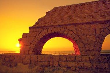 Ancient city Caesarea at sunset