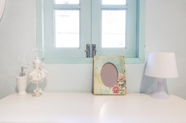 Picture flame , lamp and perfume Bottle on wooden vanity table