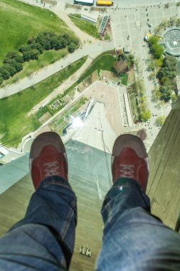 TORONTO, CANADA - MAY 7, 2007: Man's feet on the glass floor of