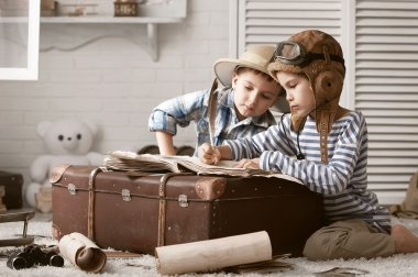 Boys traveler fill their travel book