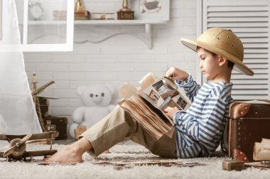 Studying boy traveler