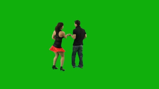 A couple dancing salsa