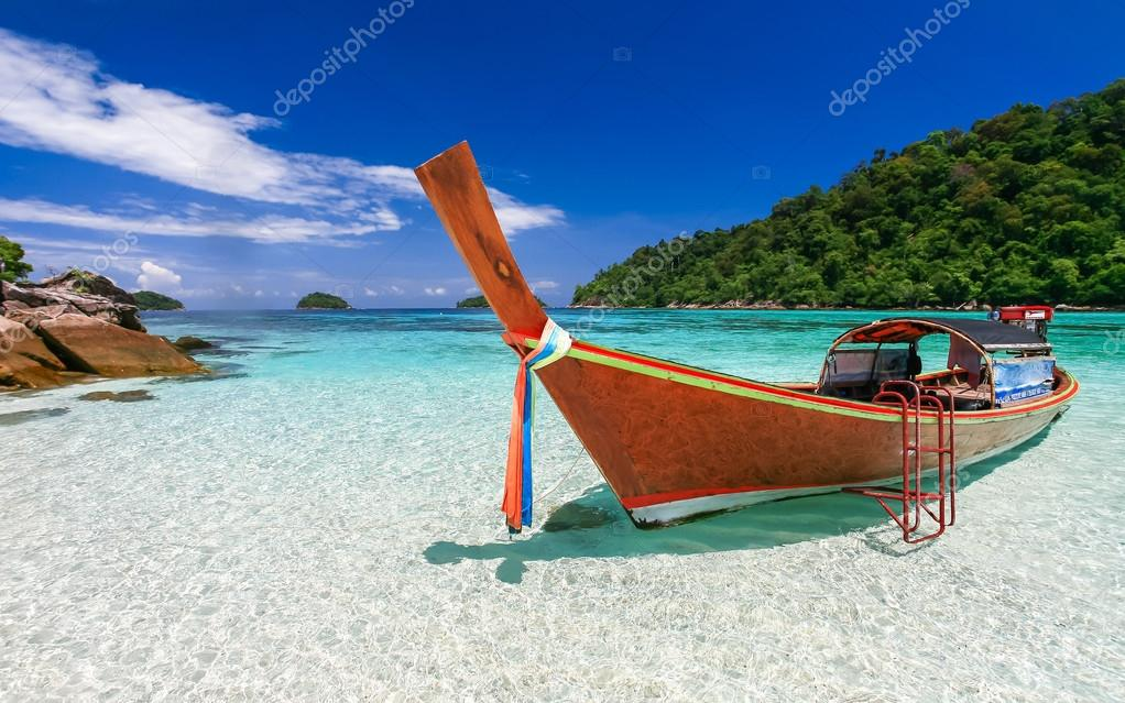 Longtail boat at tropical island