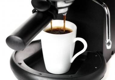 Coffee maker pouring hot coffee