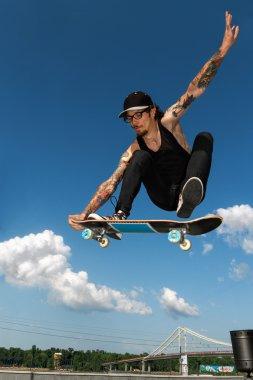 Tattooed Skateboarder stock vector