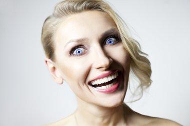 Smiling blonde girl.