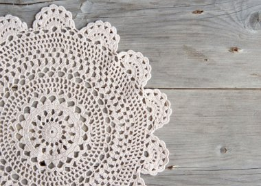 Crochet doily over old grey wood