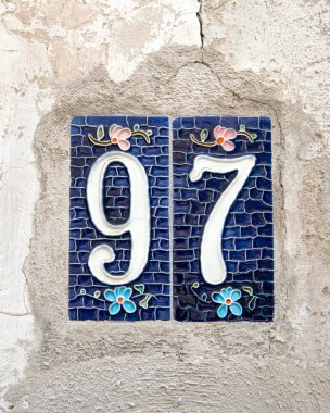 Number 97 on old wall