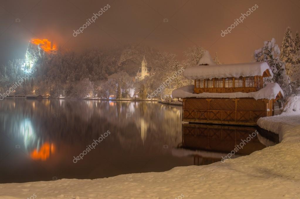 Bank Of Lake Bled In Winter Snowy Foggy Night Stock Photo