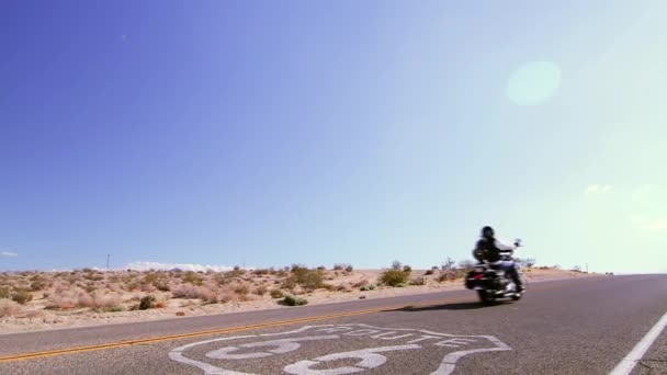 Biker on Route 66 plus sign (Cities)