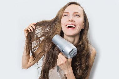 Happy woman with blow dryer