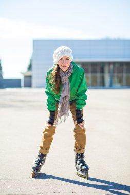 Happy young girl enjoy roller skating rollerbalding on inline skates