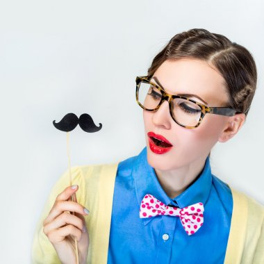 Funny cute girl in tie and mustache