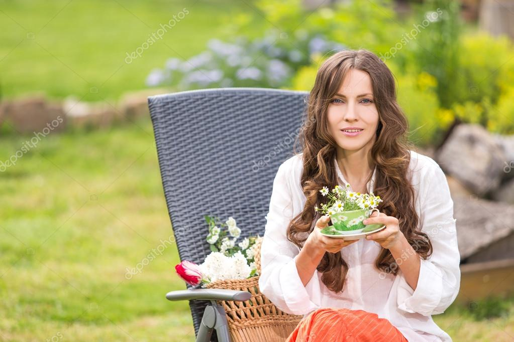 Beautiful woman drinking herbal tea