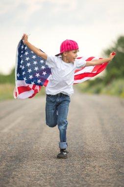 Happy boy with American flag