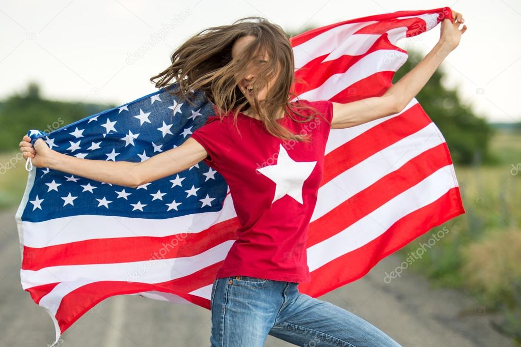 Young happy woman with American flag